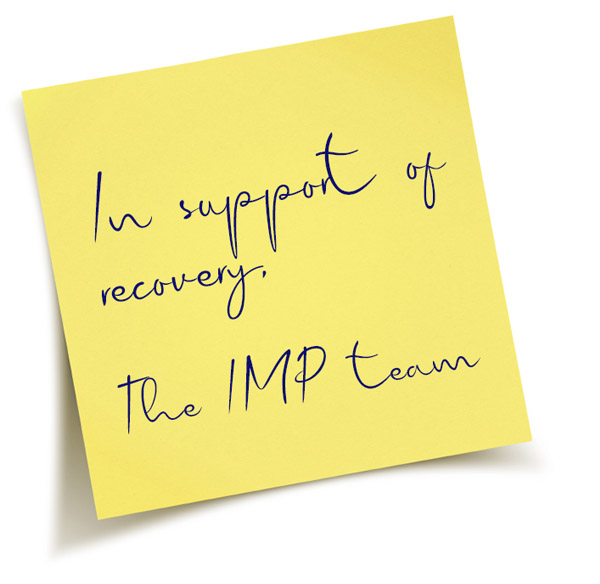 "Sticky note with the words ""In support of recovery, the IMP team"""